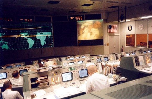 TV transmission from the Apollo 13 crew moments before the accident that crippled the mission. Fred Haise can be seen on the large screen at the upper right.