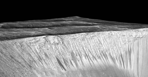 Dark, Recurring Streaks on Walls of Garni Crater. Image Credit: NASA/JPL-Caltech/Univ. of Arizona