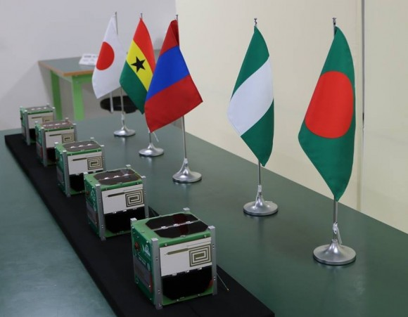 Birds-1 CubeSats by their respective nations' flags.
