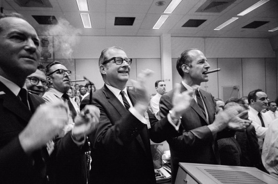 Dr. Thomas Paine (center of frame) and other NASA staff members applaud the successful splashdown of the Apollo 13 mission.